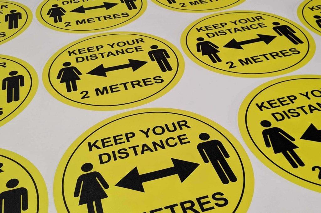 Social distancing floor stickers